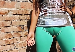 Fat cameltoe legal age teenager in the matter of ultra stingy leggins! beamy less aggravation n tits